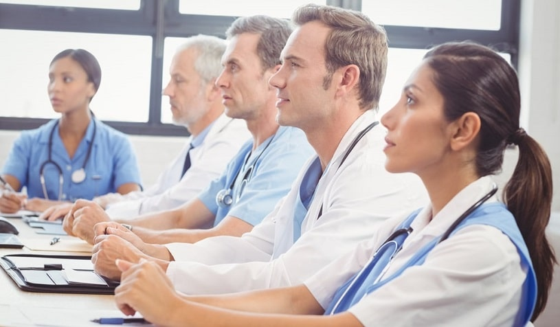 Doctors listening attentively at a Probuphine training.