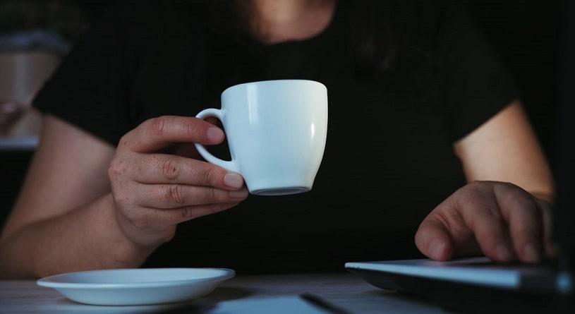 Man drinking coffee before sleep at night.