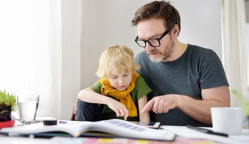 Father helping a child with ADHD.