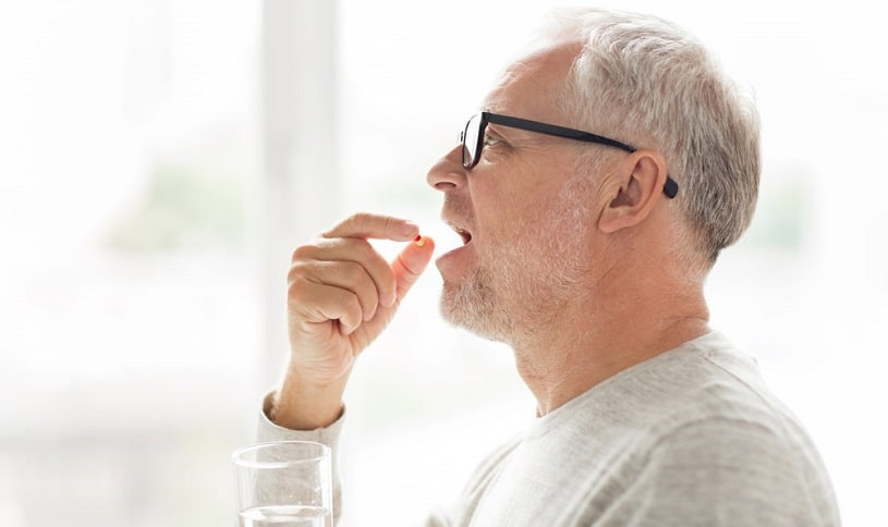Old man taking methadone for opioid addiction.