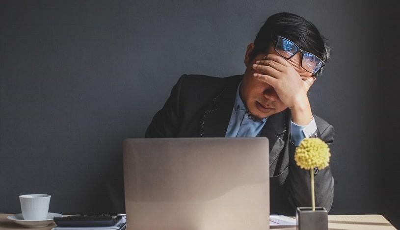 Man feeling bad after drinking coffee.