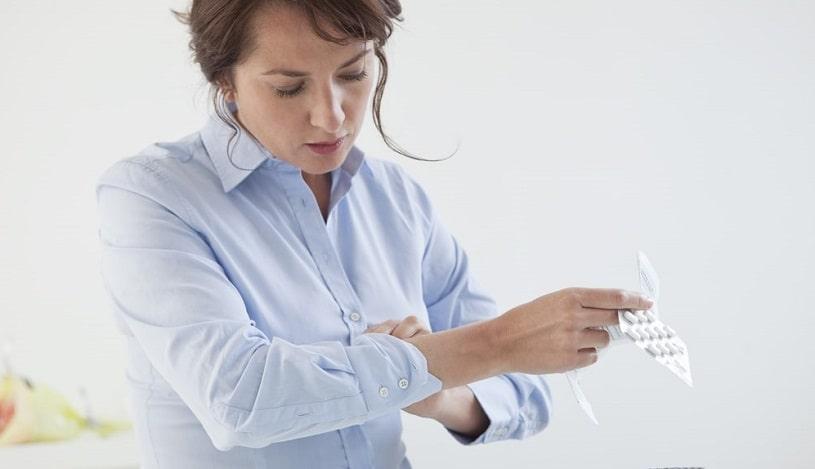 Woman taking opioid painkiller.