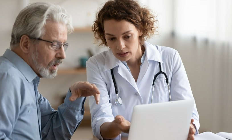 Physician explaining basics about Adderall and Strattera to a patient.