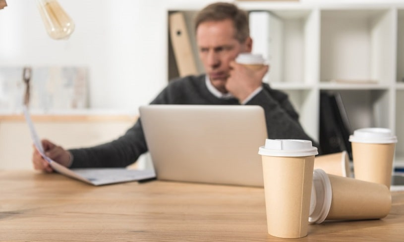 Stressed man drinking a lot of coffee.