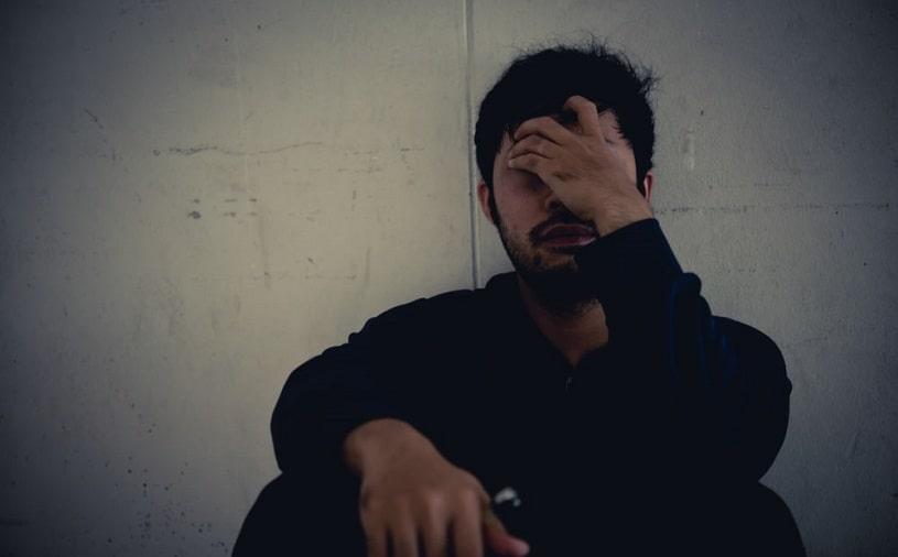 Depressed man suffering from Halcion addiction.