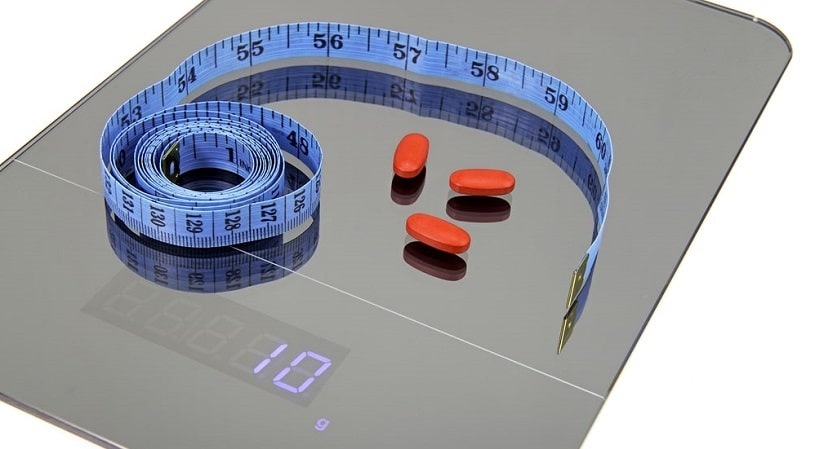 Pills and measuring tape.