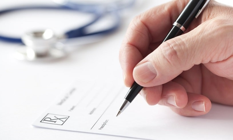 Doctor writing a prescription for Cymbalta.