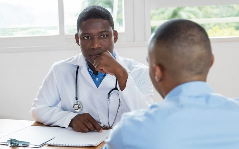Doctor listening to his patient.