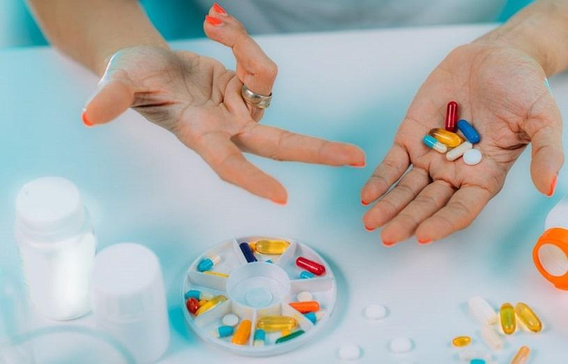 Female patient counting Librium pills.