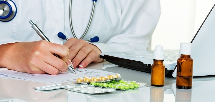 Doctor writing a presciption specifying the Meloxicam dosage.