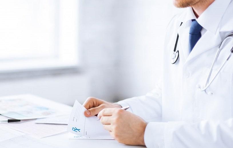 Doctor writing a Mobic prescription.