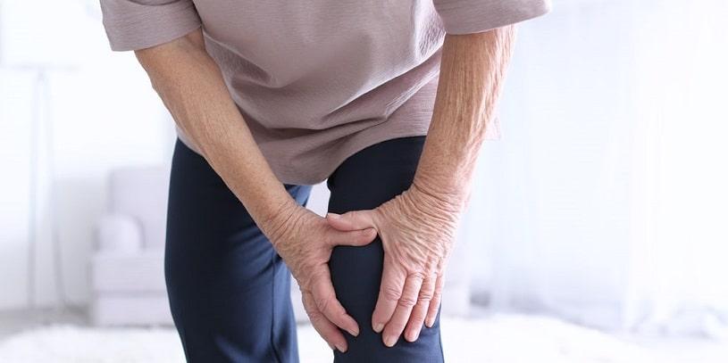 Man suffering arthritis pain at home.
