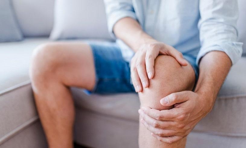 Man suffering knee pain.