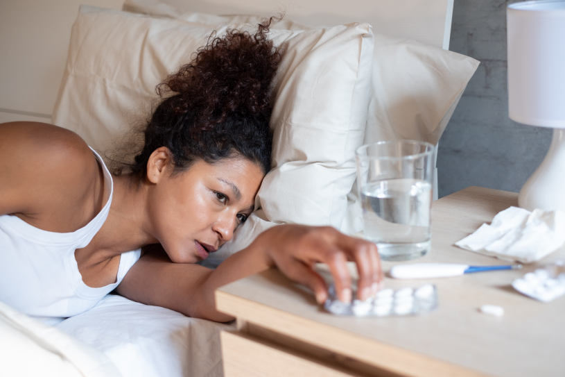 A woman is suffering from insomnia because of Vyvanse side effects.