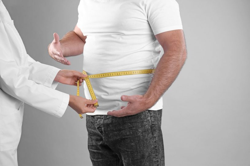 Modafinil Weight Loss: Doctor is Holding Measuring Tape