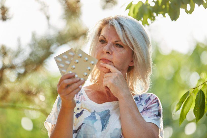 Elderly Woman is Checking 2 Medicines