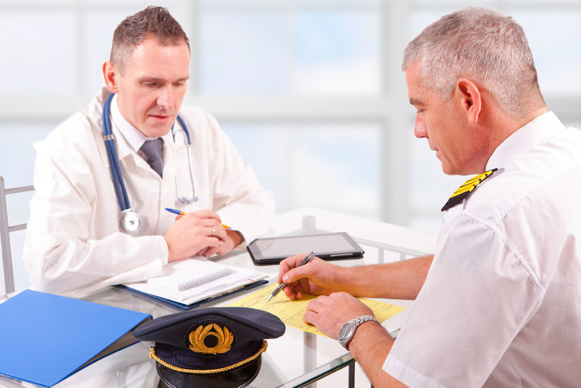 Airplane pilot during medical exam with doctor.