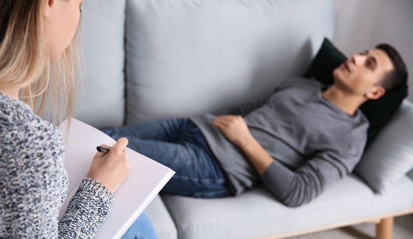 Patient lying on the couch during EMDR session.