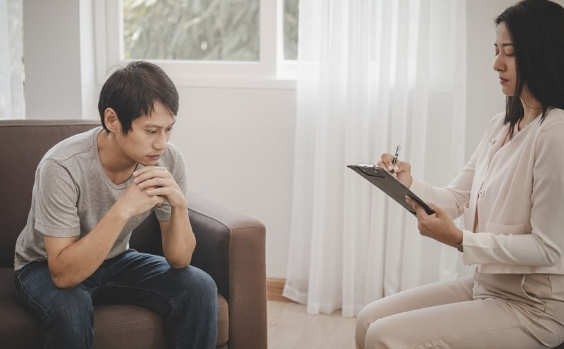Addiction psychiatrist talking to the client.