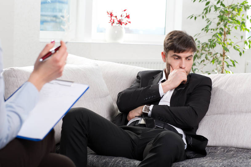 Businessman with addiction problem during counseling session.