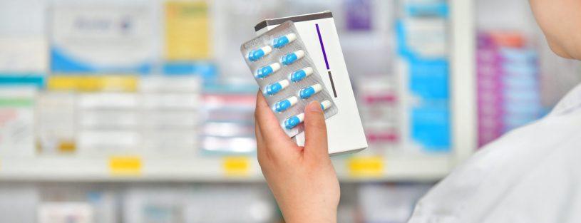Pharmacist is holding capsule pack
