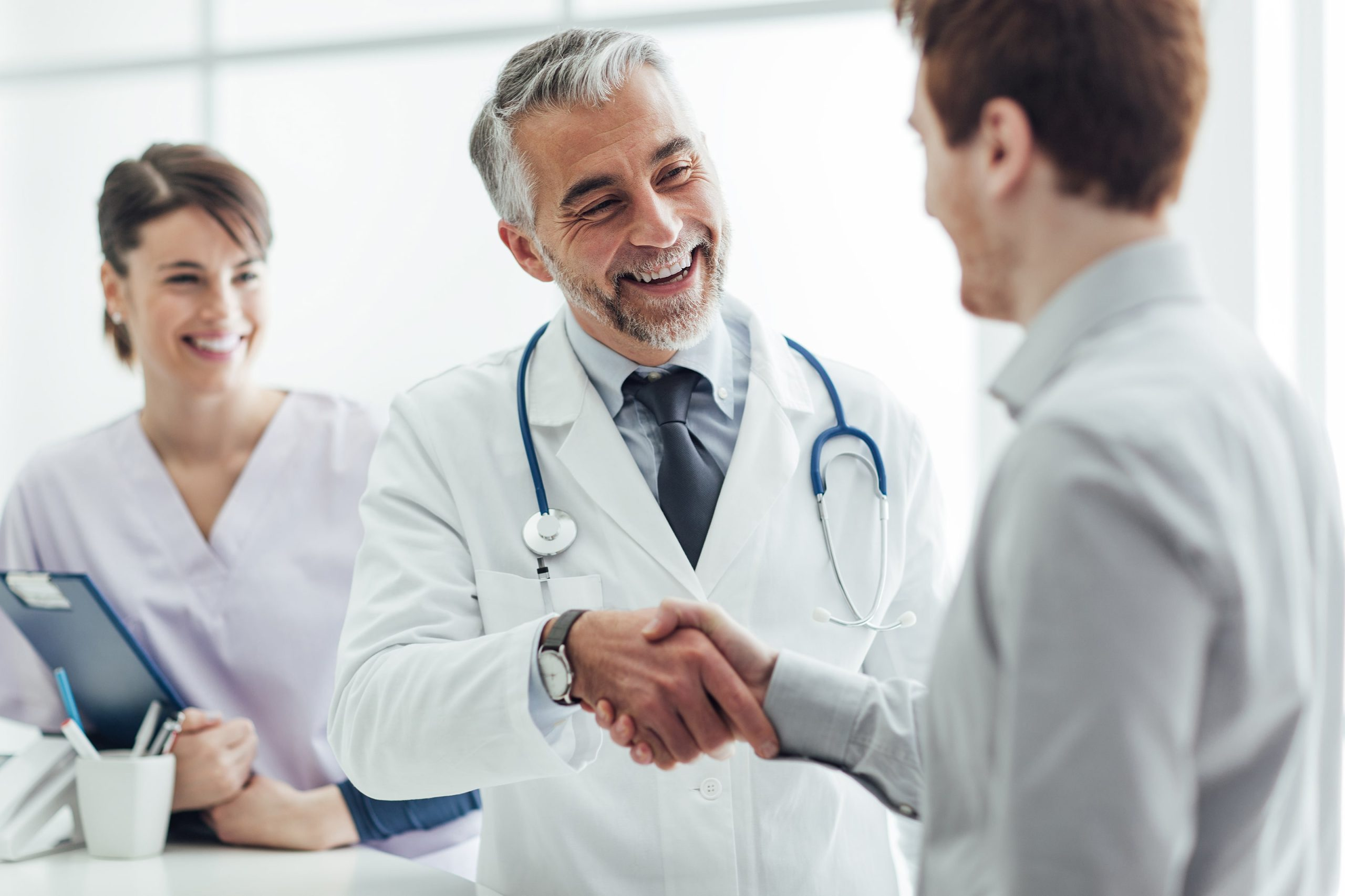 Doctor in suboxone clinic meets patient.