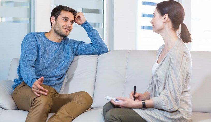 Man talking to his therapist during psychodynamic therapy.