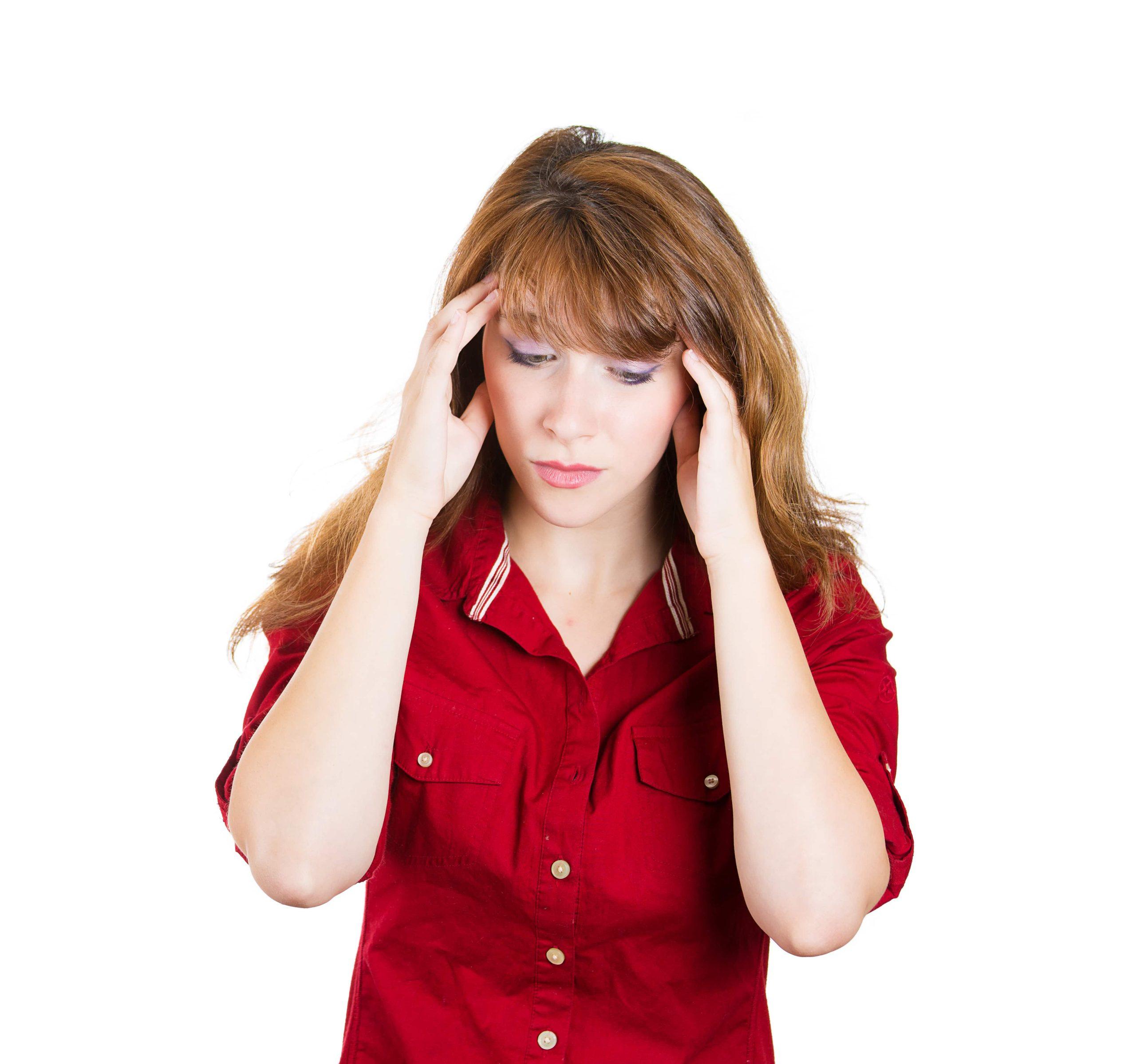 Woman is suffering from headache