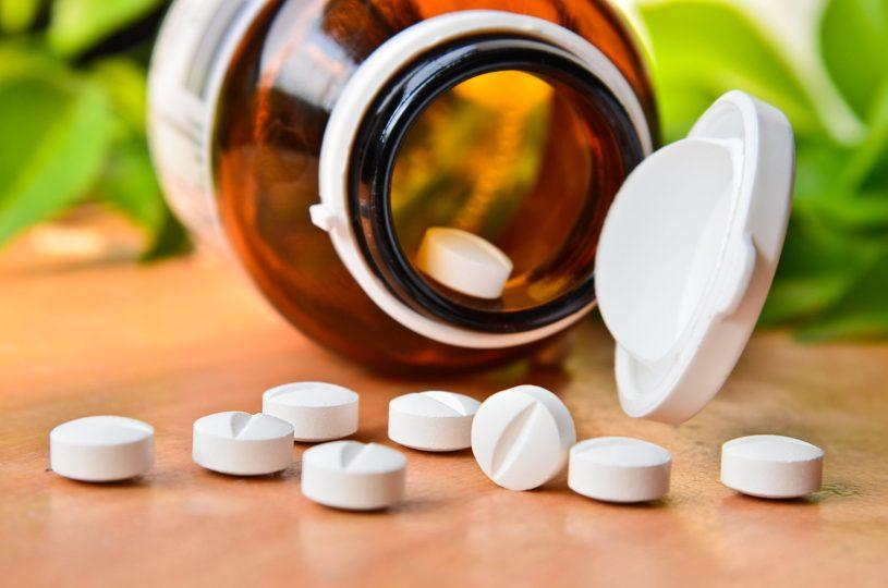 White pills on the orange table